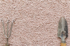 Pink background with mineral fertilizers balls. Royalty Free Stock Photo