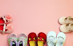Pink background for newborn babies with shoes royalty free stock photos