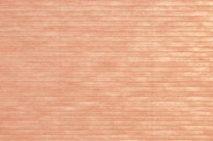 Pink background of paper. Pink lined paper background, through which some light is shimmering Stock Photo