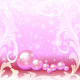 Of a pink background with a scattering of pearls and ornaments Royalty Free Stock Photography