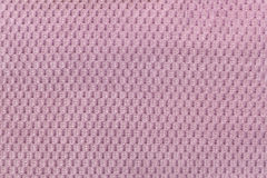 Pink background from soft fleecy fabric closeup. Texture of textile macro Royalty Free Stock Images