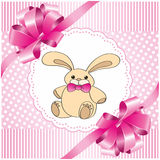 Pink background with a toy hare. Square pink background with a toy hare Stock Photography