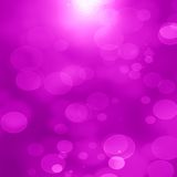 Pink background. Vivid pink background with some blurred lights in it Stock Photography