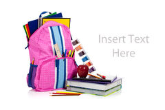 Pink backpack with school supplies with copy space Stock Photography