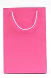 Pink bag. Pink shopping bag on white stock images