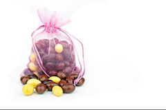 Pink bag full of chocolate eggs for easter Stock Image