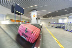 Pink bag on the luggage Carousel Royalty Free Stock Photography
