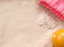 Pink bag, salt and yellow jar of cream on the natural cloth Royalty Free Stock Photo