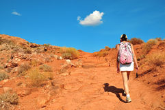 Pink Backpack Woman on the path Royalty Free Stock Photography