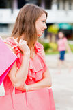 Pink Bags Held by Cute Girl in Pink Royalty Free Stock Photos