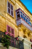 Pink balcony in malta. A photo from Malta of their famous balconies in different colors Stock Images