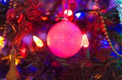 The pink ball garland. On the Christmas tree Royalty Free Stock Photo