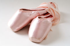 Pink ballet shoes. In a white background Royalty Free Stock Photo