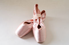 Pink ballet shoes. In a white background Royalty Free Stock Image