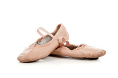 Pink ballet slippers on white royalty free stock photography