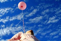 Pink balloon. Young girl holding pink balloon Stock Photo
