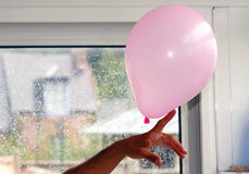 Pink Balloon on a finger Stock Photography