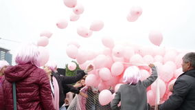 Pink balloons against breast cancer stock footage