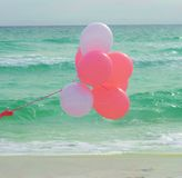 Pink balloons at the beach Royalty Free Stock Images