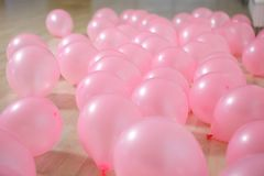 Pink balloons lying on the floor background stock images