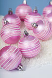 Pink balls on the snow Royalty Free Stock Photos