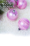 Pink balls on the snow Royalty Free Stock Photo