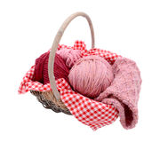 Pink balls of yarn with knitting in a basket Royalty Free Stock Image