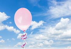 Pink baloons in the sky. One pink birthday baloon in thecloudy sky Royalty Free Stock Image