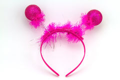 Pink band on the head with ball feather isolated on a white back Stock Images