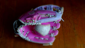 Pink baseball and glove. Royalty Free Stock Image