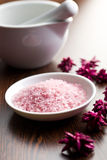 Pink bath salt in bowl Stock Photography