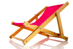 Pink beach chair. Empty pink beach chair isolated over white background Stock Photo
