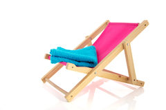 Pink beach chair with blue towel Royalty Free Stock Image