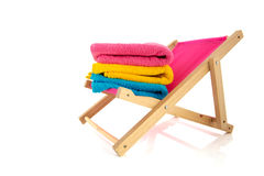 Pink beach chair with towels Royalty Free Stock Photos