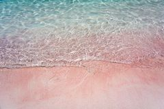 Pink Beach and Splash Wave. In Komodo National Park, Indonesia Stock Photos