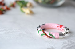 Pink beaded bracelet with the image of a panda Royalty Free Stock Images