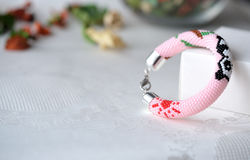 Pink beaded bracelet with the image of a panda Stock Image