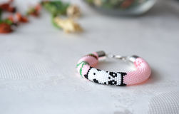 Pink beaded bracelet with the image of a panda Stock Images