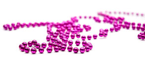 Pink beads. On a white background