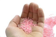 Pink beads for craft on isolated background stock photo