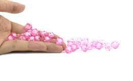 Pink Beads On Hand Royalty Free Stock Image