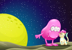 A pink beanie monster pacifying the cat in the outerspace Stock Photo