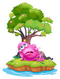 A pink beanie monster resting under the tree house in the island Stock Image