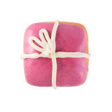 Pink bear donut isolated. Doughnut in the form of a gift with pink frosting and a white bow on a white background isolated close-up top view Stock Photo