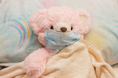 Pink bear is ill in a bed. Medicical concept Royalty Free Stock Image