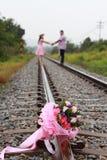 Pink beautiful flower wedding on railway Stock Photos