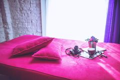 Pink bed & pillows royalty free stock photography
