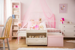 Pink bedroom with canopy bed Royalty Free Stock Photography