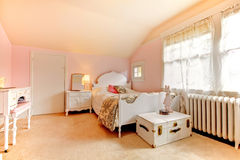 Pink bedroom with white bed and nightstand Stock Photo