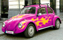 Pink beetle car. With yellow flames Royalty Free Stock Photos